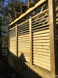 Pergola With Movable Louvers by Exterior View Of A Louvered Fence Project The Hardware System