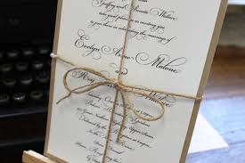 simple script invitation tied up with a rustic twine wedding