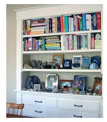 Bookcase With Baskets Organizing And Arranging Bookshelves Kara Leigh Interiors