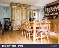 Country Dining Room Tables by Wheel Back Chairs And Pine Table In Country Dining Room With Large