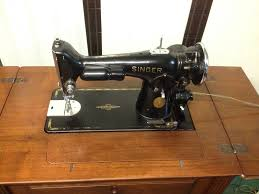 vintage 1936 singer sewing machine in beautiful wooden cabinet