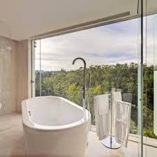 bathroom black bathtub egg shaped white floor large glass windows
