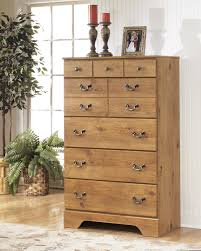 Price Busters Furniture Store by Ashley B219 46 Bittersweet Rustic Pine Grain 5 Drawer Bedroom Chest