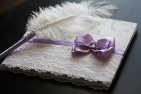 purple guest book purple white signin book and ostrich feather violet pen wedding
