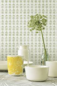 kitchen cabinet wallpaper green floral pattern yellow glass cup white wallpaper designs