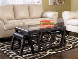 square black leather coffee table with ottomans and purple shag