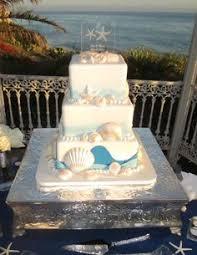 Cake Decorations Beach Theme - elegant beach themed white butter cream wedding cake with shells