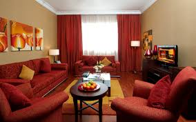great arabic living room with red sofa and yellow walls red and