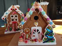 wooden gingerbread houses painted and decorated with fake candies