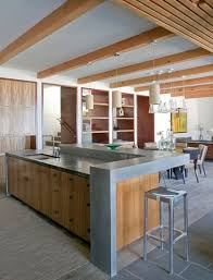 kitchen island with raised bar raise the back of the island to hide cooking clutter in an open