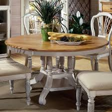 hillsdale wilshire round two tone leaf dining table fmg local