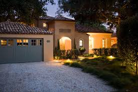 stucco exterior gravel driveway terracotta roof blue garage