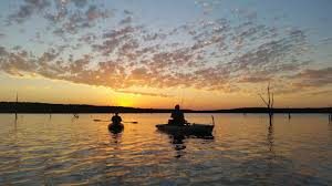 volunteers give vets a day on the water freedom boat club kayak fishing heroes on the water