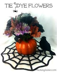 tie dye flowers make a with spooky house and tie dye flowers