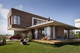 simple modern homes simple modern house design two distinct blocks brick volume home