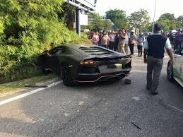 crashed red lamborghini malaysia an alleged tan sri u0027s 16 years old son illegally drove a