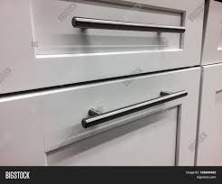 modern handles for white kitchen cabinets white kitchen cabinets image photo free trial bigstock