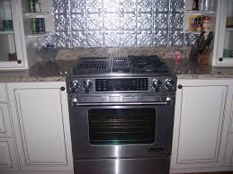 interior range with tin backsplash and cabinets tin backsplash