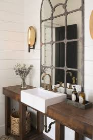 country powder room with farmhouse sink wall sconce zillow
