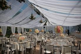 Sheer Draping Wedding Light Peaking Through Soft Sheer White Fabric Swagged From The