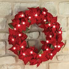 the 24 cordless prelit poinsettia wreath hammacher schlemmer