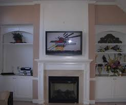 mounting tv over fireplace make that outdated hole above