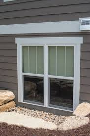 Basement Window Well Drainage by Egress Window For Basement With Rocks For Natural Window Well And
