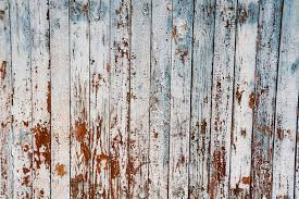 old peeling blue paint on weathered wood as a detailed grunge