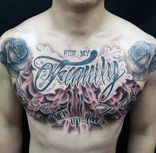 guys chest roses and purple flamed family tattoos