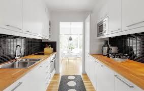 long kitchen idea with black backsplash and kitchen runner rug and