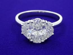 oval depth and table ring with 1 22 carat oval brilliant cut graded f