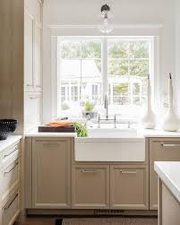 katie acorn sconce over farmhouse sink transitional kitchen
