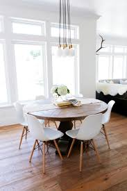 best 25 small round kitchen table ideas on pinterest white dining room rustic round wood table surrounded by white eames dining chairs creates an interesting mix in this transitional eat in kitchen