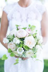 a sweet and simple bridal bouquet for a backyard wedding brides