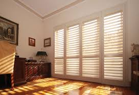 decorating cozy wood tile flooring with plantation blinds and
