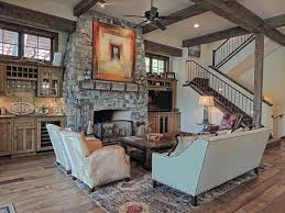 pictures of living rooms with fireplaces country living room with high ceiling columns in whitefish mt