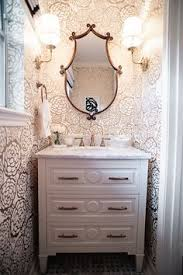 gray powder room features walls clad in gray sisal wallpaper lined