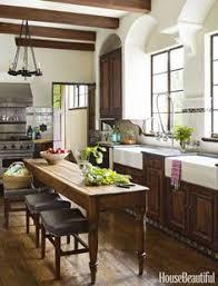 True Mediterranean Kitchen - black and white mediterranean kitchen with carved wood door