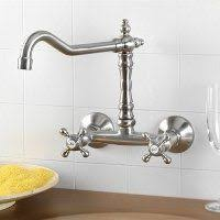 wall mounted faucets kitchen a wall mount traditional style faucet looks great with a white
