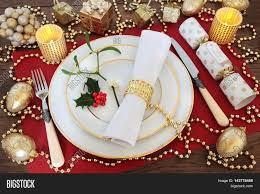 christmas dinner table setting with white plates antique knife christmas dinner table setting with white plates antique knife and fork linen serviette
