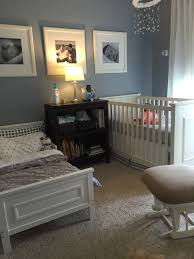 shared nursery neutral room for toddler boy and baby baby