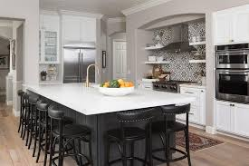 charcoal gray island with black counter stools transitional