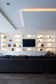 living room open plan seating feature built in wall shelving