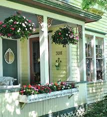 farmhouse porches porch decorating ideas pink impatiens on a yellow farmhouse porch