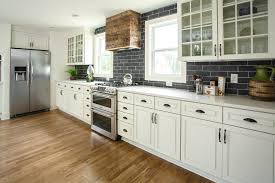 black kitchen cabinets with white subway tile backsplash 18 subway tile backsplash ideas that are totally timeless