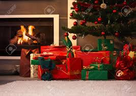 still life photo of presents and christmas tree in living room