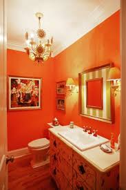 charming small bathroom with orange wall decor with vanity and