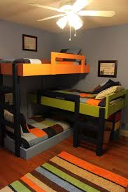 three bunk beds saving space and staying stylish with triple bunk beds