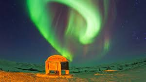 neon green northern lights in the arctic circle