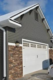dark gray siding with stone accents white trim michaud house